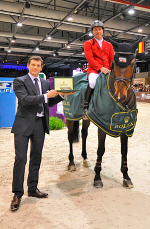 Hans Dieter Dreher and Magnus Romeo are presented with awards for ther win by M. Arnaud Reverdin, Commercial Director Rolex France.
