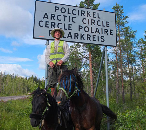 Lithuanian Vaidotas Digaitis, pictured with his horses Kredas and Kaklys,at the Arctic Circle.