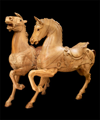 Two carousel horses, made in Philadelphia between 1880 and 1900, by Gustav Dentzel and Daniel Müller.