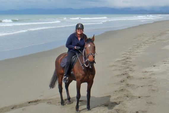 Julie Gordon and Bert enjoying a beach ride.