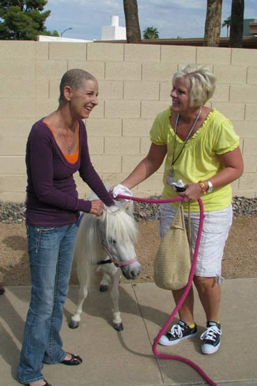 Debbie Hillery, left, and Brook Mortsensen with Lilly. Photo by Jon Kamman