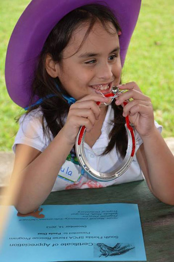 All of the children received a horseshoe with their name engraved on it in Braille after their visit.