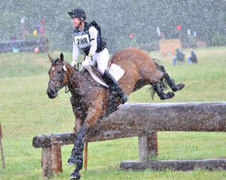 Avi and Karen on the way to a double-clear cross-county round in the torrential hailstorm at Inavale Farm.