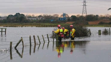 An RSPCA rescue team wades through flood waters in Christchurch. Credit: Fire Aid/Simon Rowley