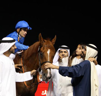 Sheikh Mohammed bin Rashid Al Maktoum greets African Story and Silvestre De Sousa after their win in the Dubai World Cup.