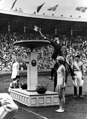 A horseman lights the Olympic cauldron in Stockholm after the torch relay.