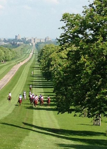 Endurance competitors stretch out on the grounds at Windsor.