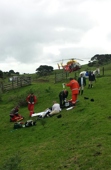 Paramedics treat the injured rider before airlifting her to Auckland. Photo: Westpac Rescue - Auckland/Facebook