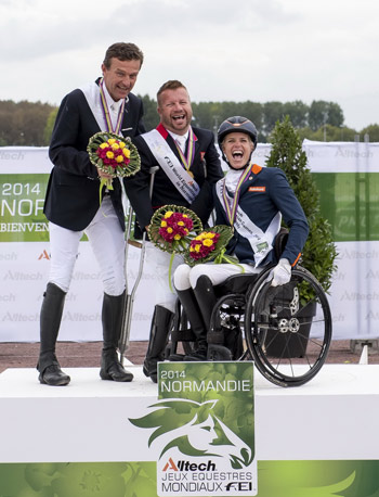 Great Britain's Lee Pearson (centre) celebrates clinching the Grade Ib individual title at the Alltech FEI World Equestrian Games 2014 with Austria's Pepo Puch taking silver and The Netherlands' Nicole Den Dulk scoring bronze.