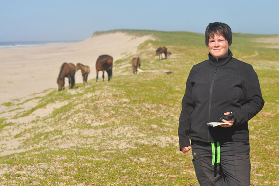 Sarah Medill records location and descriptions of a band of horses on Sable Island. Photo: Kathrine Stewart