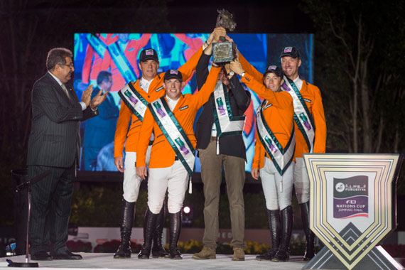 The Netherlands' team celebrate victory in the Furusiyya FEI Nations Cup™ Jumping 2014 Final in Barcelona, Spain. From left, Prince Faisal of Saudi Arabia and Dutch team members Jeroen Dubbeldam, Gerco Schroder, Chef d'Equipe Rob Ehrens, Maikel van der Vleuten and Jur Vrieling.
