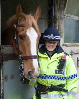 Ross before his retirement, with Constable Caroline Middleton.