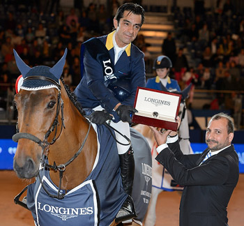 Colombia's Carlos Lopez, winner of the sixth leg of the Longines FEI World Cup Jumping 2014/2015 Western European League in Madrid, Spain, with Prince de la Mare, and Longines Brand Manager for Spain, Miguel Angel Palmer.