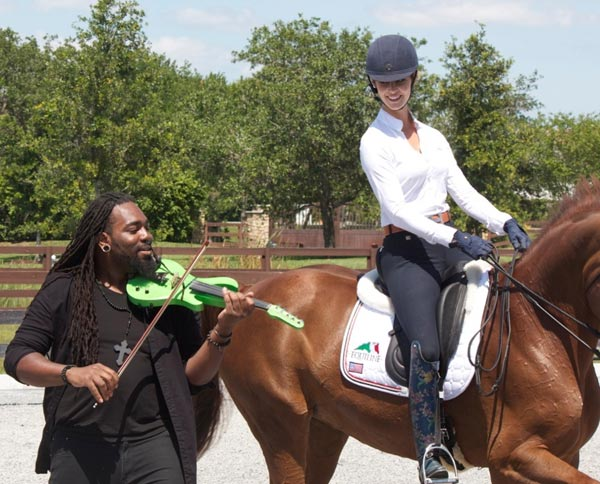 Grand Prix dressage rider Caroline Roffman dances with her horse as DSharp plays the violin.