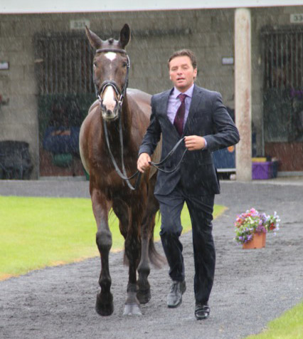 Dan Jocelyn braves the rain for the trot-up at Tattersalls.