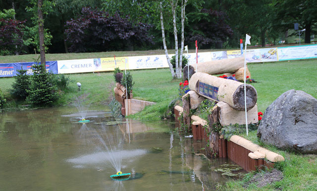 Fountains help keep the water moving to improve the equine view of the obstacle.