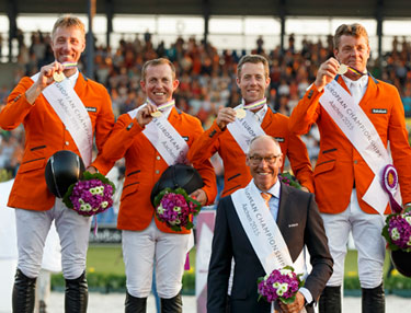The Netherlands team of, from left, Jur Vrieling, Gerco Schroder, Maikel van der Vleuten and Jeroen Dubbeldam with Chef d'Equipe Rob Ehrens after winning team gold at the FEI European Jumping Championships 2015 in Aachen, Germany.