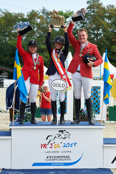 Young Rider medallists Kaya Luthi from Germany (silver), Ebba Larsson from Sweden (gold) and Guido Klatte from Germany (bronze) at the FEI European Jumping Championships for Children, Juniors and Young Riders 2015 at Wiener Neustadt, Austria.