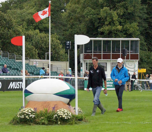 Mark Todd and Niklas Bschorer walk the cross-country course.
