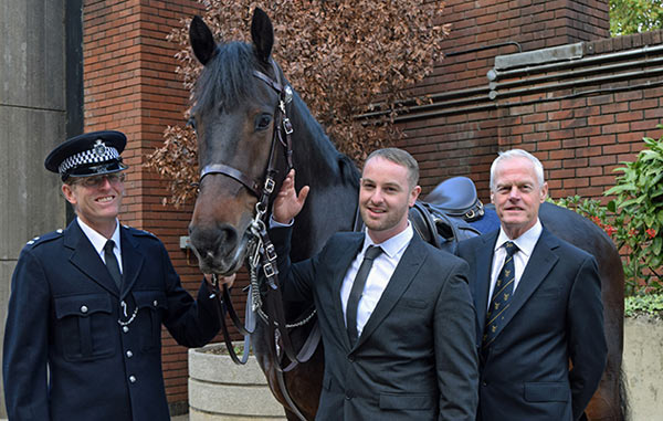 At far right is Metropolitan Police horse trainer Alistair Blamire, who was riding Quixote at the time of the attack, is pictured with David Wilson and PC Andrew Hill, who was riding alongside Alistair and Quixote on another horse.