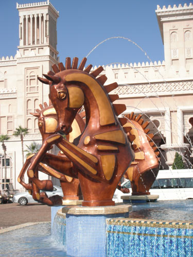 The equine fountain at the front of Al Qasr was created by South African sculptor Danie de Jager, as were the above golden arabian horses.