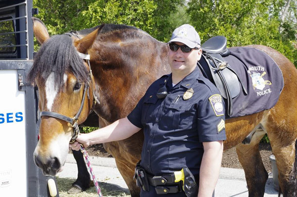 Big John with Sgt. Ray Reid, commander of the Plymouth Police Department's mounted unit.