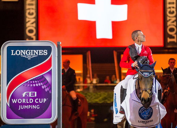 Pius Schwizer during the Swiss national anthem after winning the Zurich Longines FEI World Cup Jumping leg on PSG Future on Sunday.