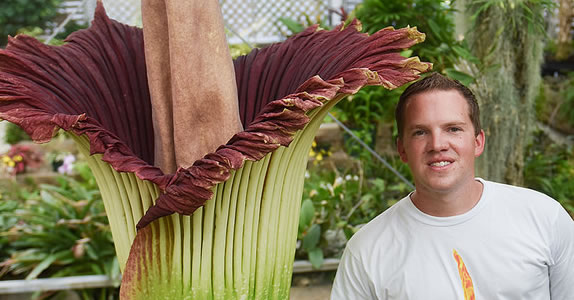 Brandon Huber standing with Lupin, the corpse flower.