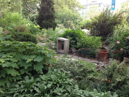 Meandering cobble paths take you through this small garden.