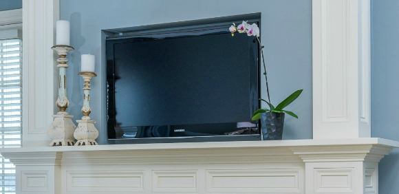 television above fireplace