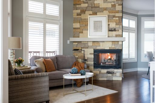Hoskins-Interior-Design_Indianapolis-IN_Smart-and-Stunning-Family-Friendly-Home-Design_Living-Room-Sofa-and-Chair-with-Fireplace