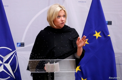 FILE - Then-Dutch Defense Minister Jeanine Hennis-Plasschaert delivers a speech in Brussels, Belgium, Feb. 16, 2017.
