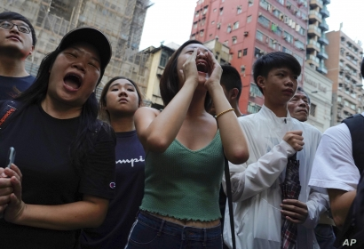 Demonstrators shout slogans during a protest in Hong Kong, Oct. 12, 2019.