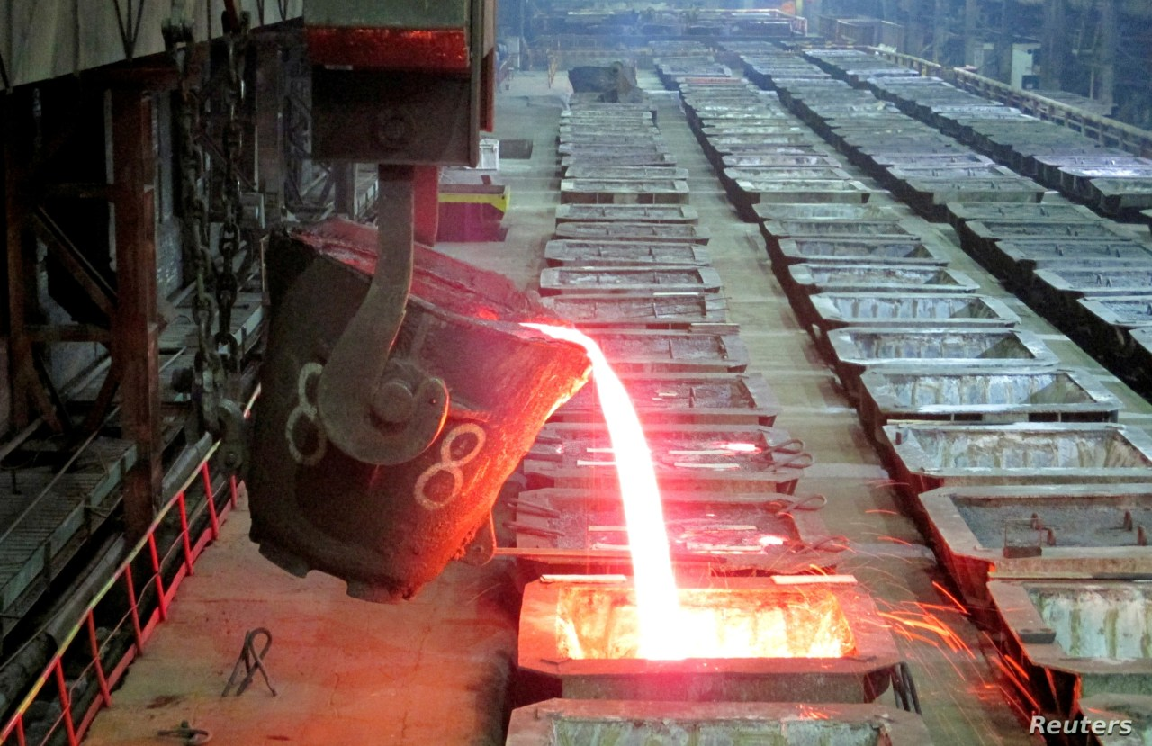 FILE - Molten nickel is poured at the Norilsk Nickel company's Nadezhda Metallurgical Plant in the Arctic city of Norilsk, Jan. 23, 2015.