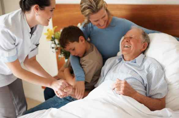 Home Health Aide Assisting Hospice Patient and Family