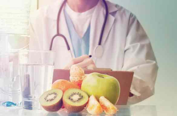 Hospice doctor next to food and liquids on a table