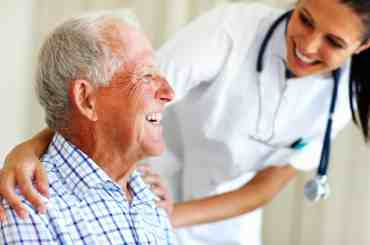 Hospice patient laughing with hospice nurse