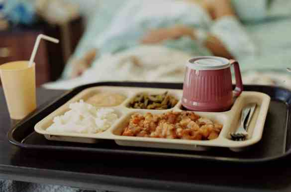 Patient by Bed Stops Eating and Drinking