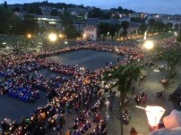 The main square in Lourdes Holy District during a procession of lights