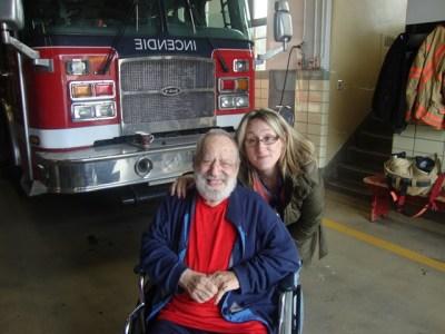 Jewish Eldercare resident Gerald Reinharz visiting the fire station with Recreation Specialist Josie DiBenedetto.