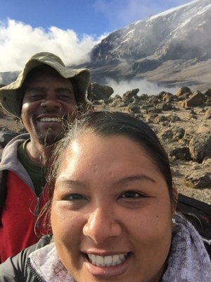Brandi Ng-See-Quan and her guide 'Good Luck' at the start of her ascent of Mt. Kilimanjaro