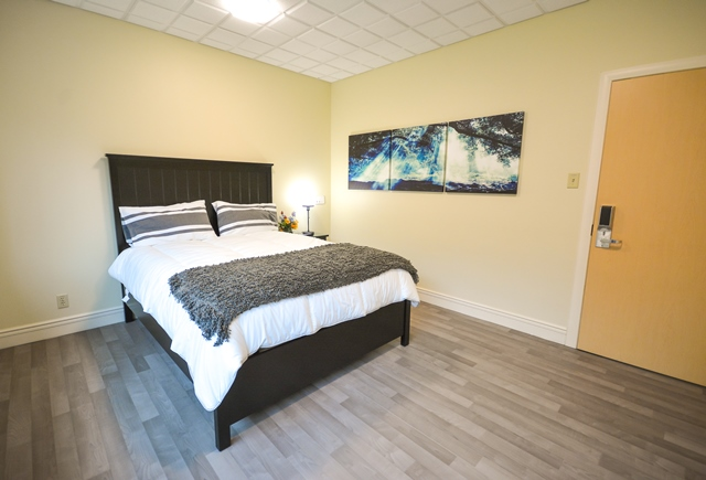 One of two family guest suites on the family and caregiver floor of the new Palliative Care Unit, for families who want to stay overnight. It contains a bathroom spa, closet and flat screen television.