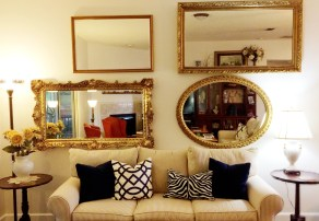 Using four large, gold mirrors, we opened up the room and created something interesting on an otherwise large blank wall.