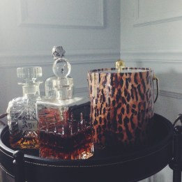 Treat leopard as a glamorous neutral. You won't have to hide your ice bucket any longer.