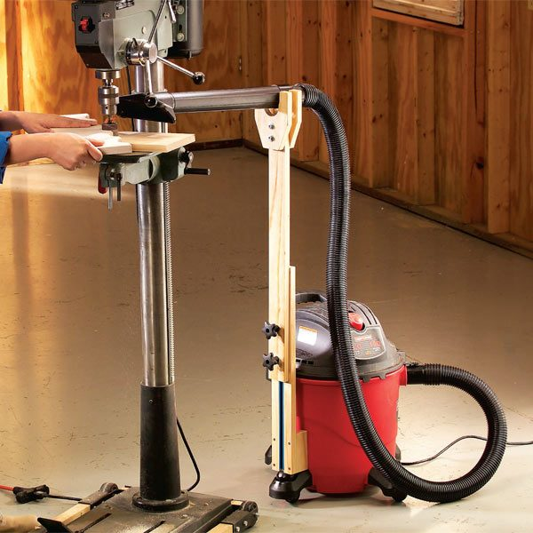 ... vacuum hose holder attaches to the shop vacuum and can be rolled into