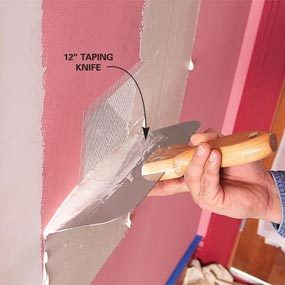 Apply two thin coats of drywall mud. Then sand when dry.