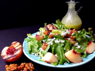 The natural sweetness of the grilled peaches and the contrast of the jalapeno honey dressing make this salad healthy and delicious. | HostessAtHeart.com