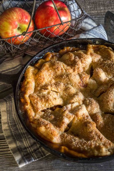 Beautiful and rustic Skillet Apple Pie has a buttery crust that's filled with a delicious warm cinnamon-apple filling. - HostessAtHeart
