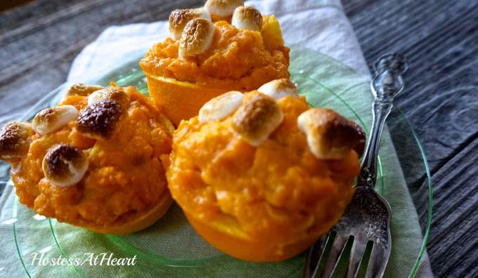 Orange Cup Sweet Potatoes add a bright citrus to your sweet potatoes and a beautiful fall color to your holiday table. They're perfect to make for two or a crowd. - HostessAtHeart