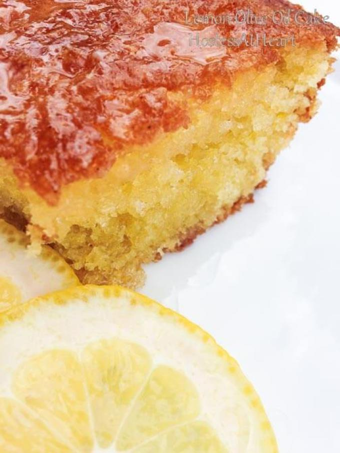The color of this Lemon Olive Oil Lemon Cake is gorgeous, the smell is amazing, and best of all, it's easy to put together. - HostessAtHeart